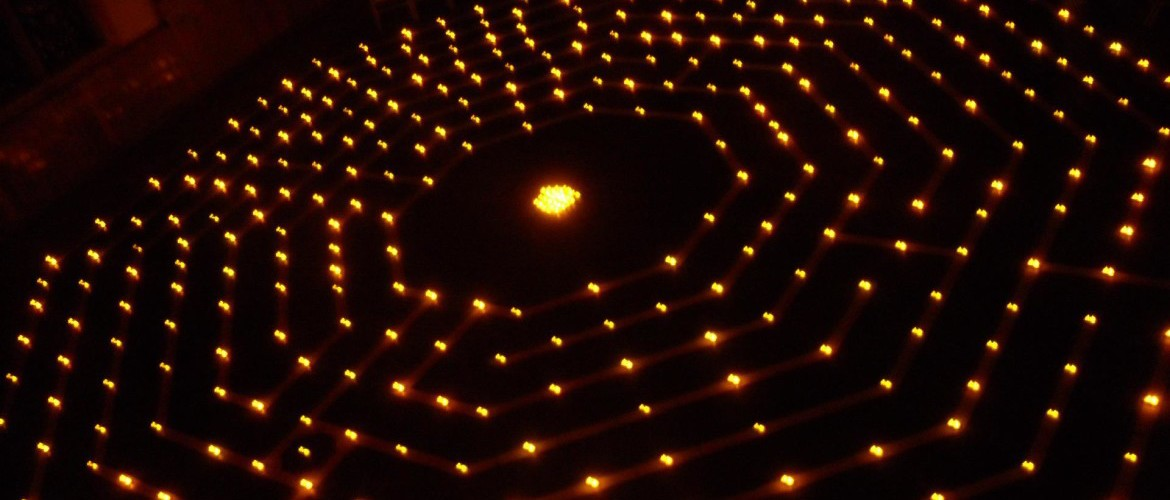 lit candles along the labyrinth