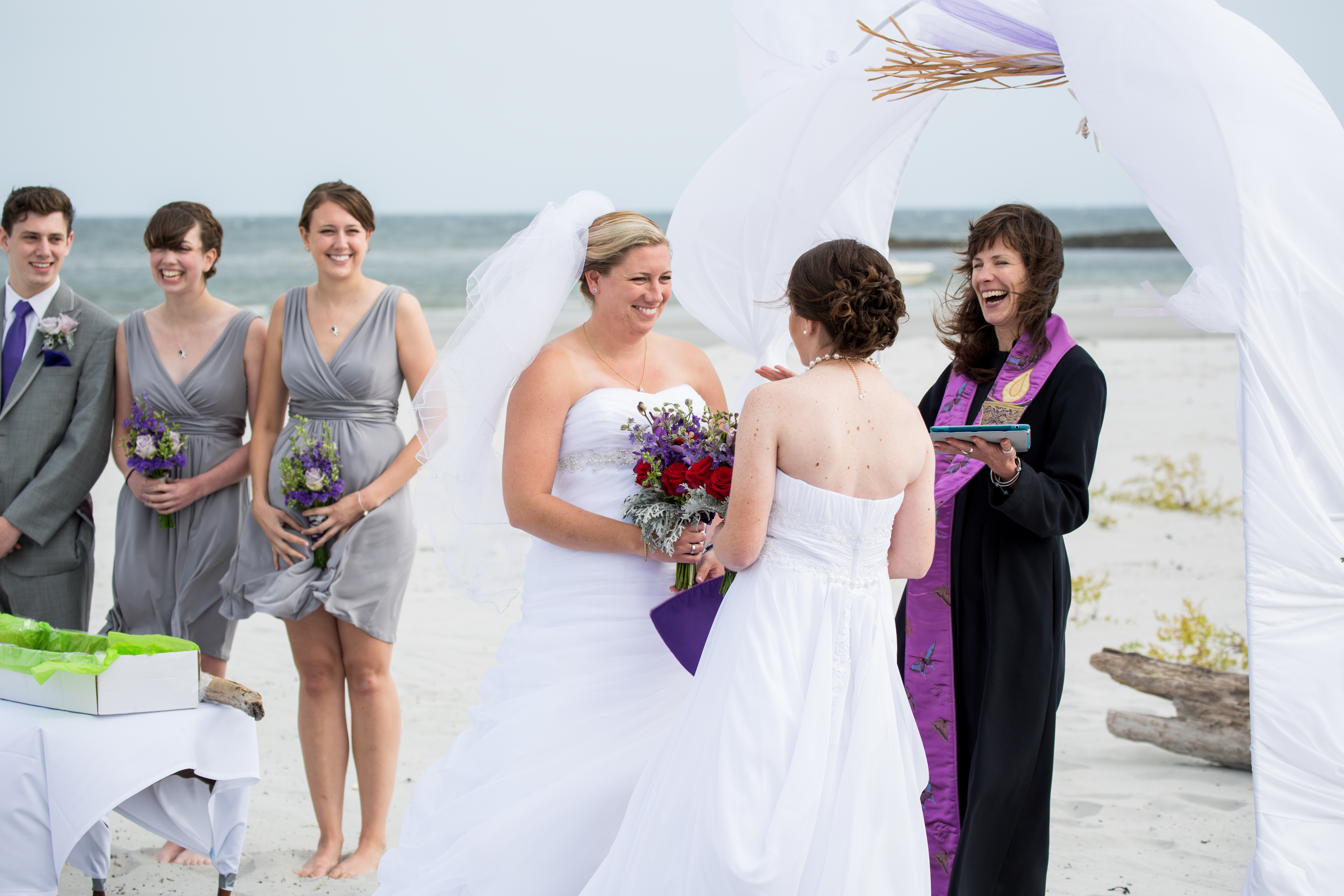 Two women getting married at the beach