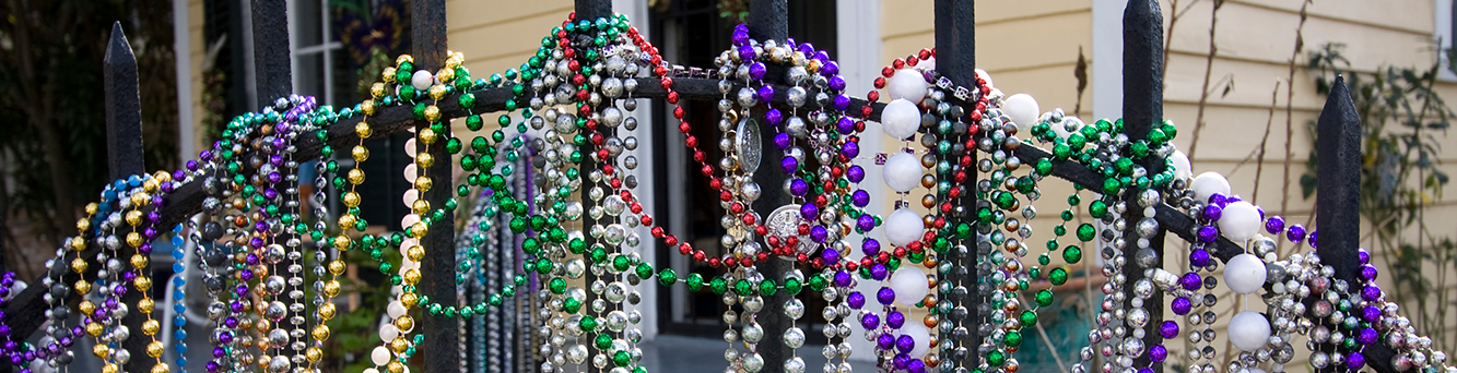Mardi Gras Bead decorating an iron gate